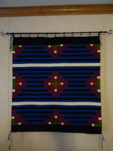 Voila! One Navajo weaving wall mounted for display