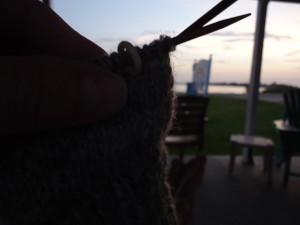 Working on my mitten and watching the sun set on Cedar Key, Fl