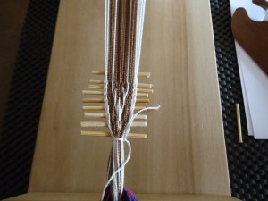 The first pattern repeat. Skewers are used to spread the warp and provide a firm base to beat against.