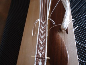One skewer where the usable band starts. I like the motifs and the way this band weaves up.