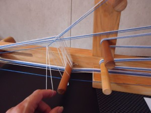 Adding a heddle to a warp
