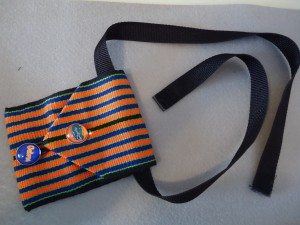 Completed pouch with hang tab on back and webbing with hook and loop tape