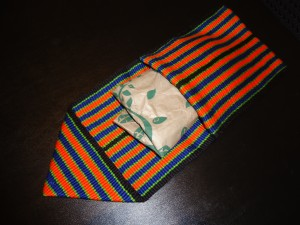 Creating pouch by folding band in half with a flap