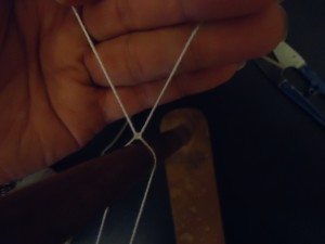 Tie heddle using a surgeon's knot