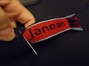 Double-Face Tablet Woven Name Plate sewn to handle grip