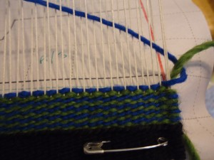 The wefts hook at the selvage